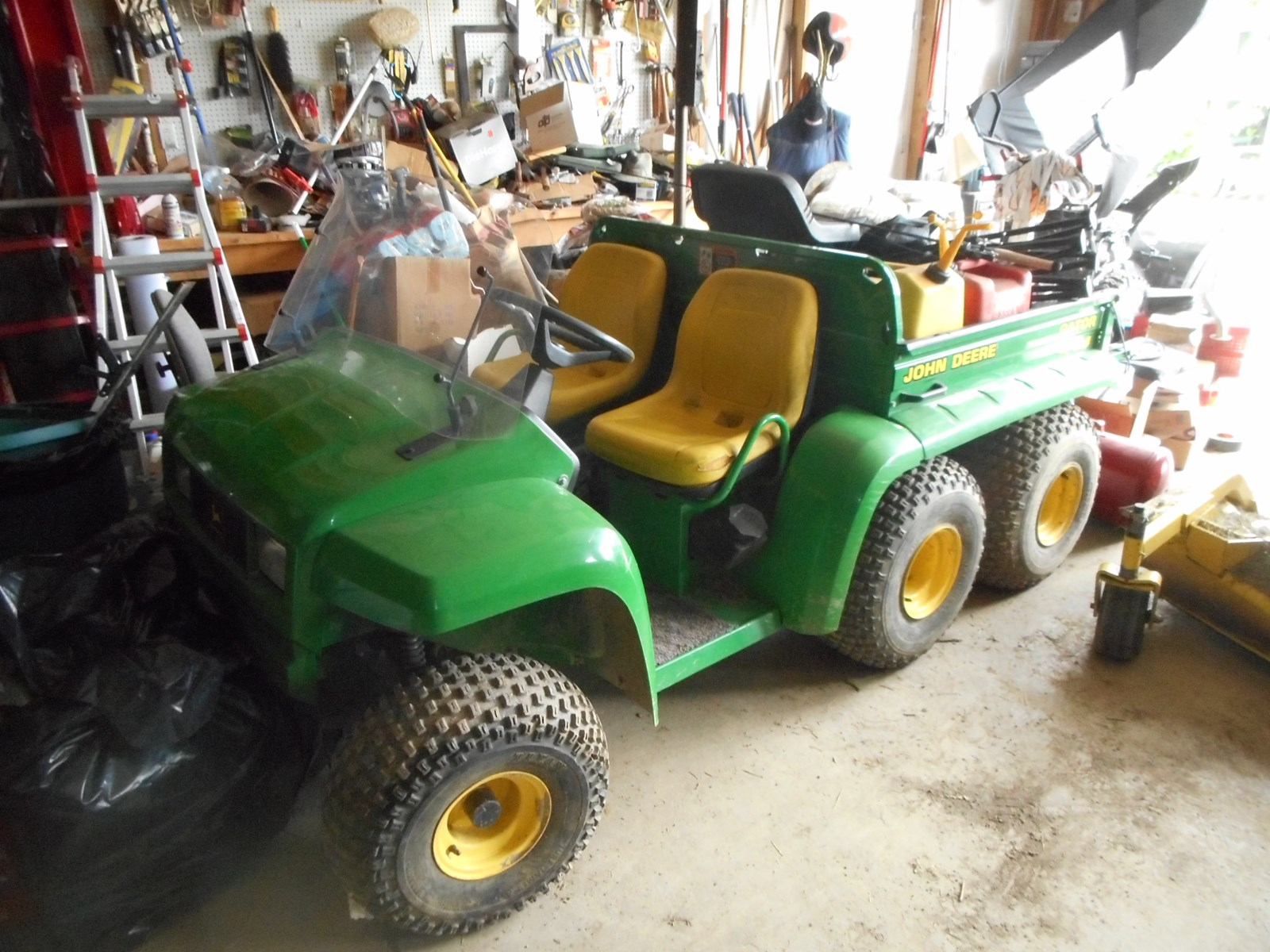 Public Auction - Backhoe, Gator, Tools, Lift, Motor Home and more!