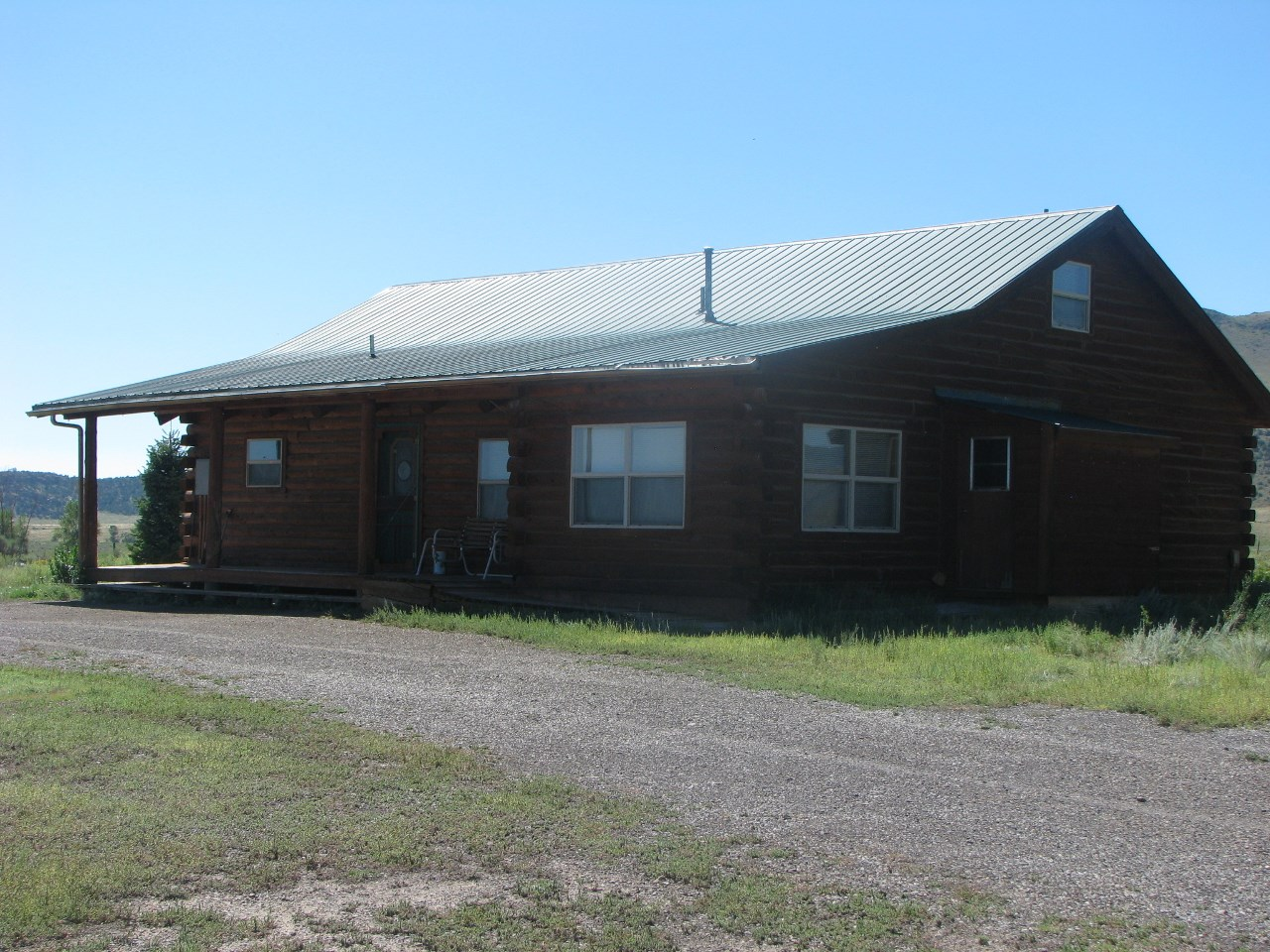 LOG HOME, GARAGE/WORKSHOP, HORSE BARN AND CORRAL, MTN VIEWS