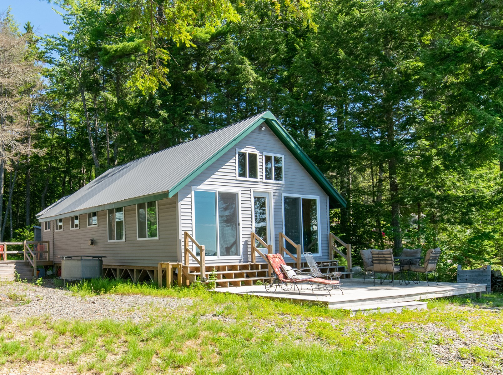 Lakefront Camp on a Pebble Beach For Sale in Maine