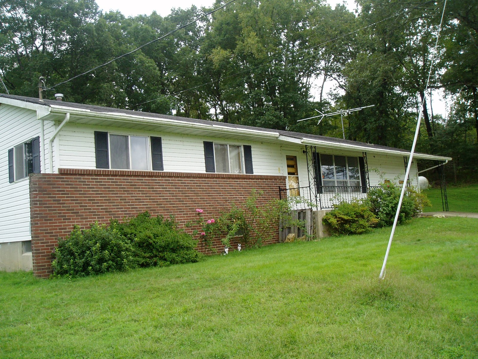 Three Bedroom 1 bath home with basement on fifteen Acres