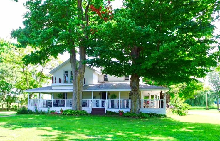 Beautiful historic farmhouse on 10 acres with pond and class