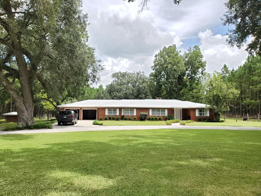 3 bedroom 2.5 bath Farmhouse with 23+ acres Chiefland, FL