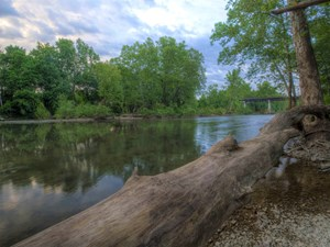 MISSOURI OZARK RIVER PROPERTY WITH CABINS AND CAVE..