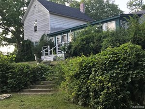 HISTORIC COUNTRY HOME WITH OVER 19 ACRES!