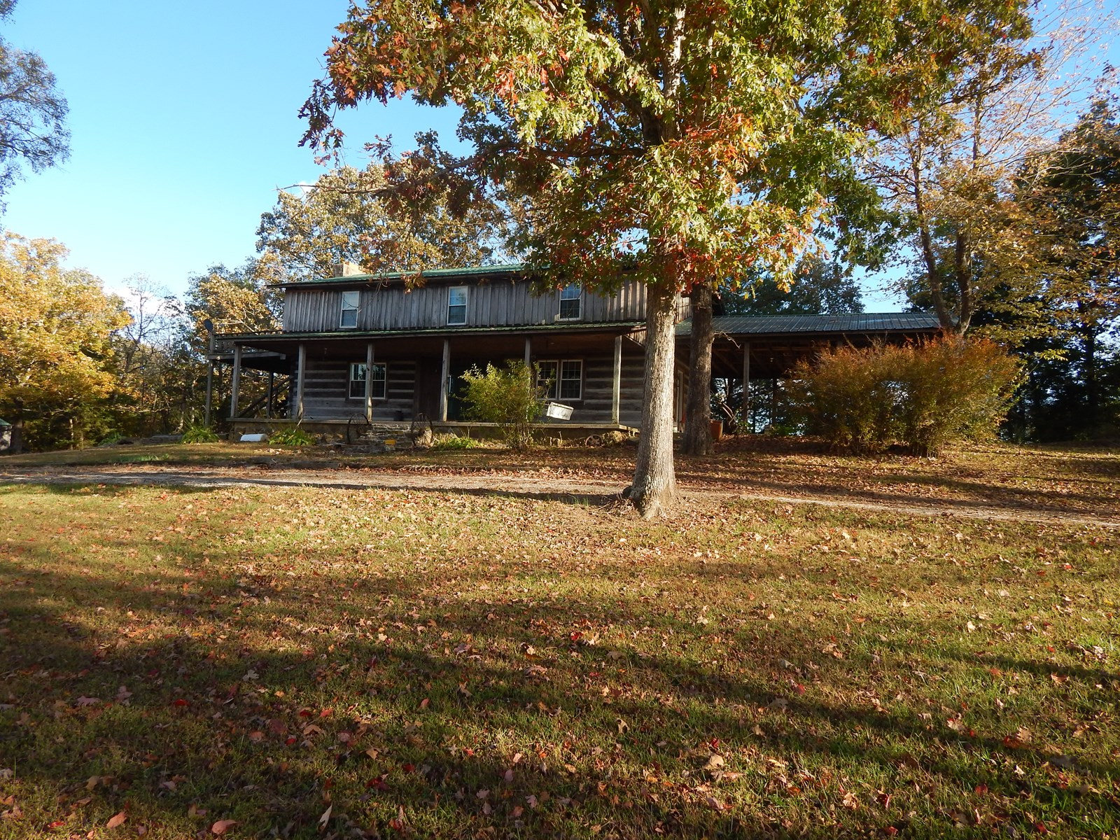 RUSTIC HOME ON APPROXIMATELY 4 ACRES