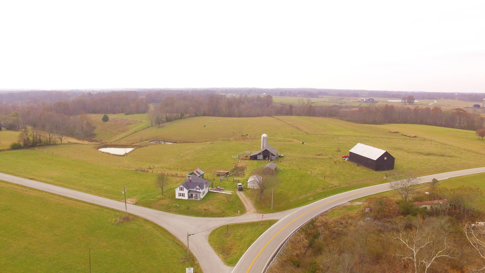 20.86 +/- acre home with outbuildings and barns with silo