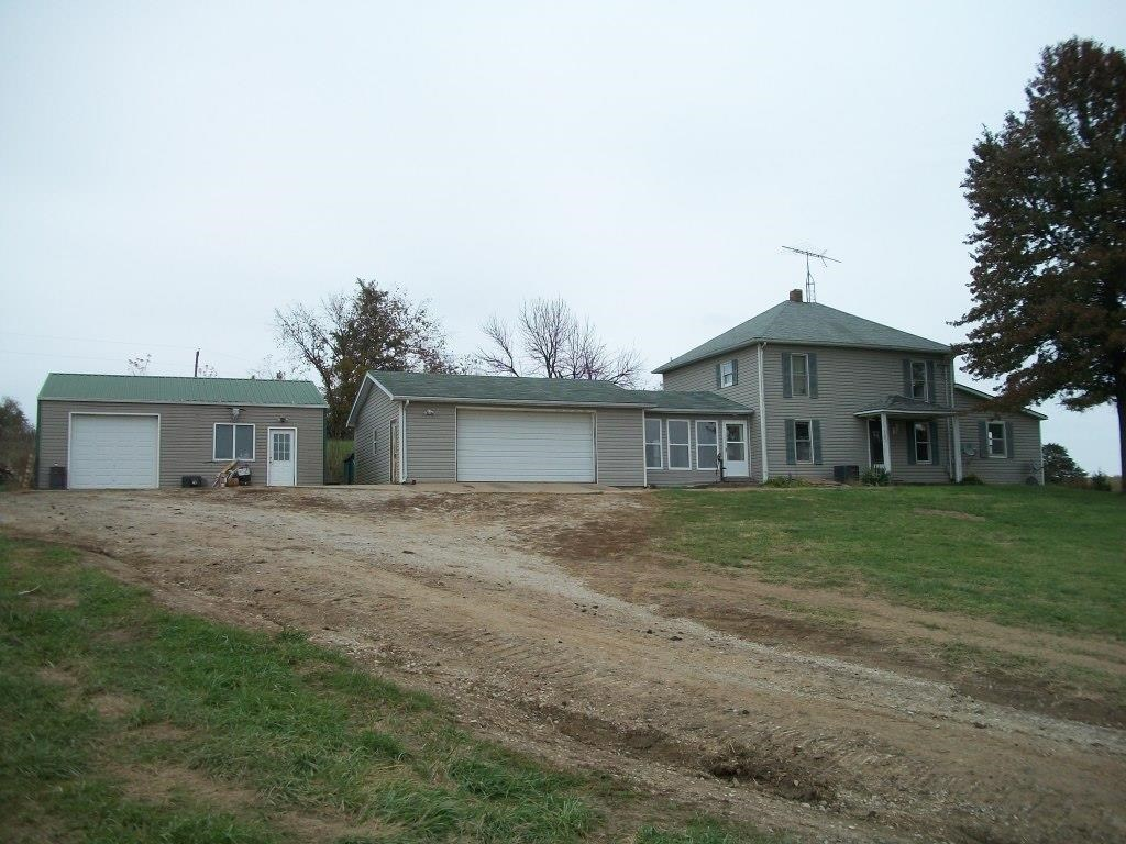 Country Home with Outbuildings on 4 ac m/l near Luray MO