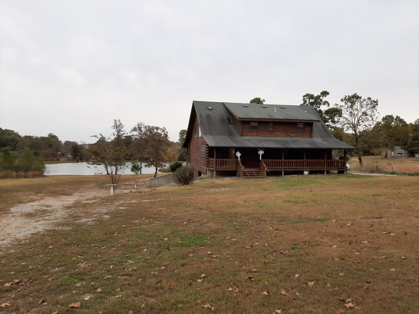 2 Story Log Home with Stocked Lake