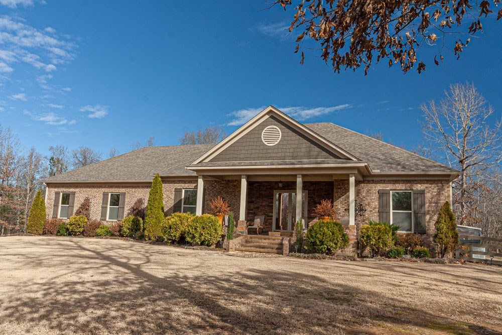 Private Setting: Custom Brick Home with Shop, Barn & Pasture