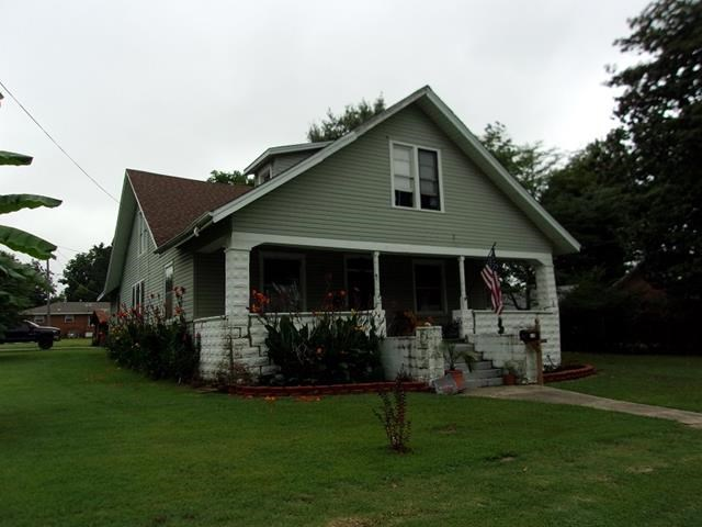 Large home on corner lot Rector
