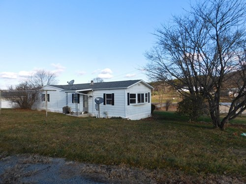 Nice mobile home on 3/4 acre lot with city water/sewer.