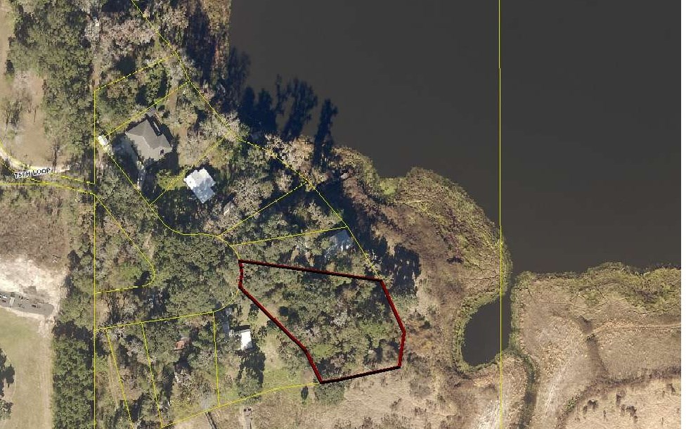Very wooded Lake front lot.