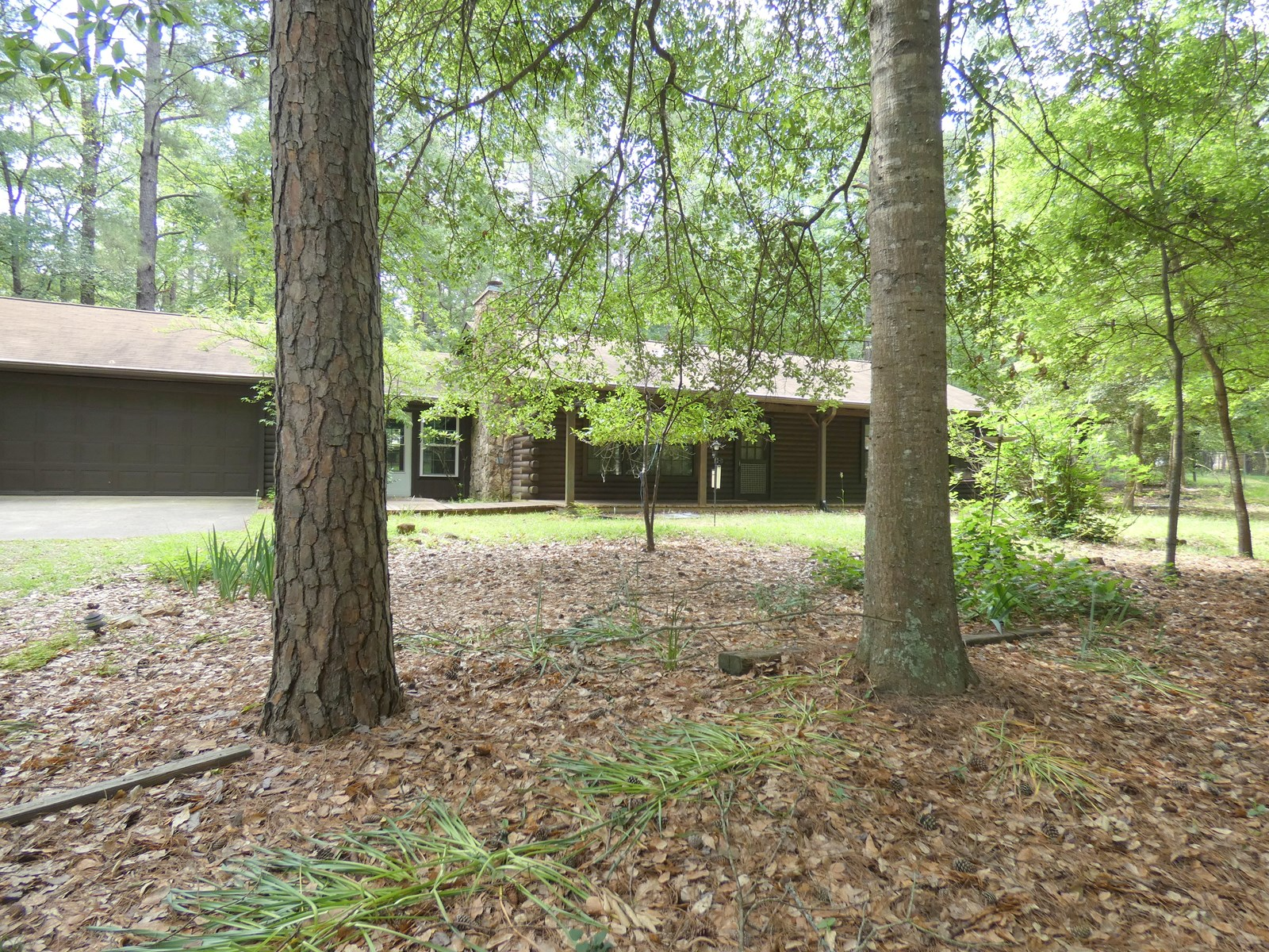 HOLLY LAKE RANCH EAST TEXAS LOG CABIN IN THE WOODS FOR SALE