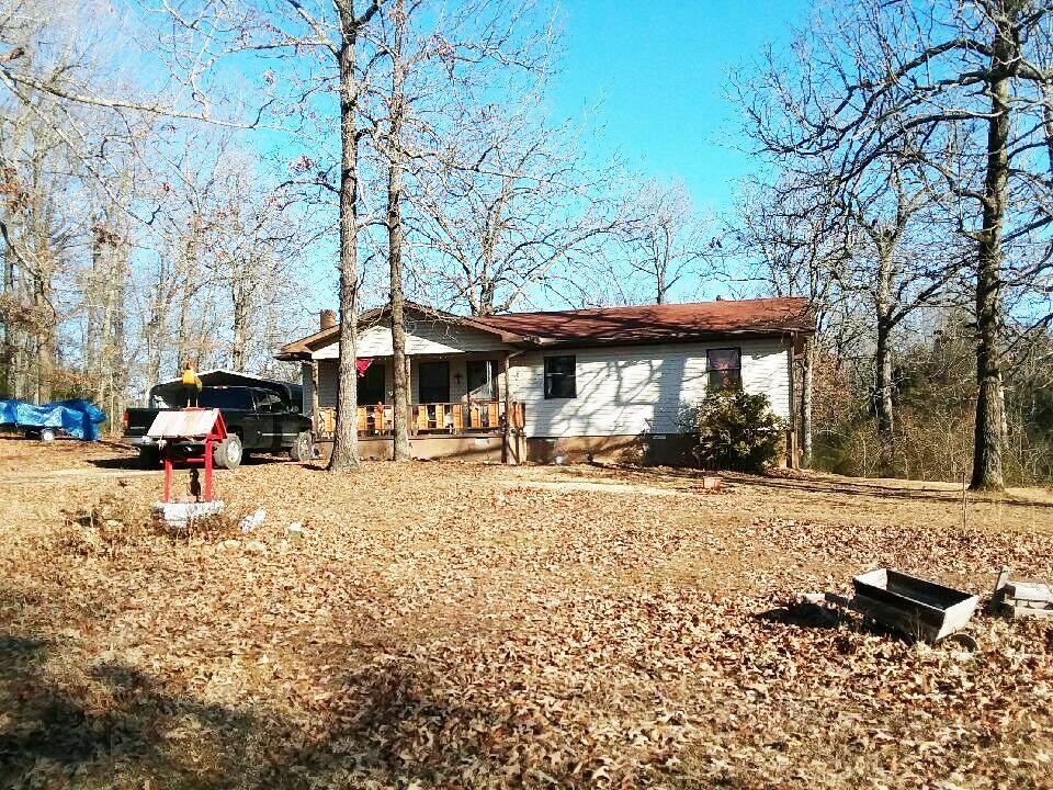 Home in city limits but country feel for sale in Highland,AR