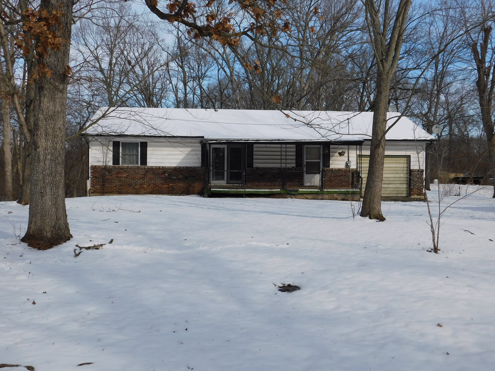 2 BR 1 Bath ranch sitting on 6.55 Acres with pond