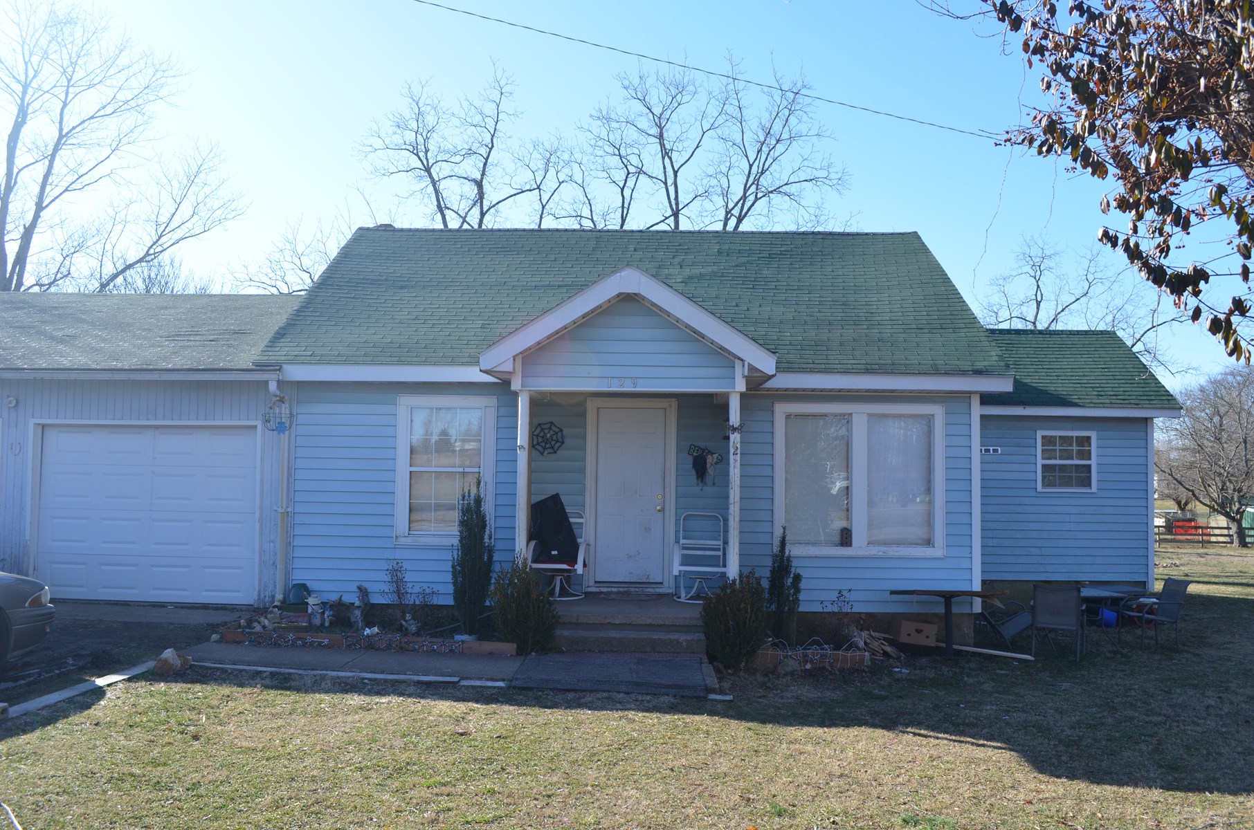 2 bedroom, 2 bath home with city utilities, country setting.