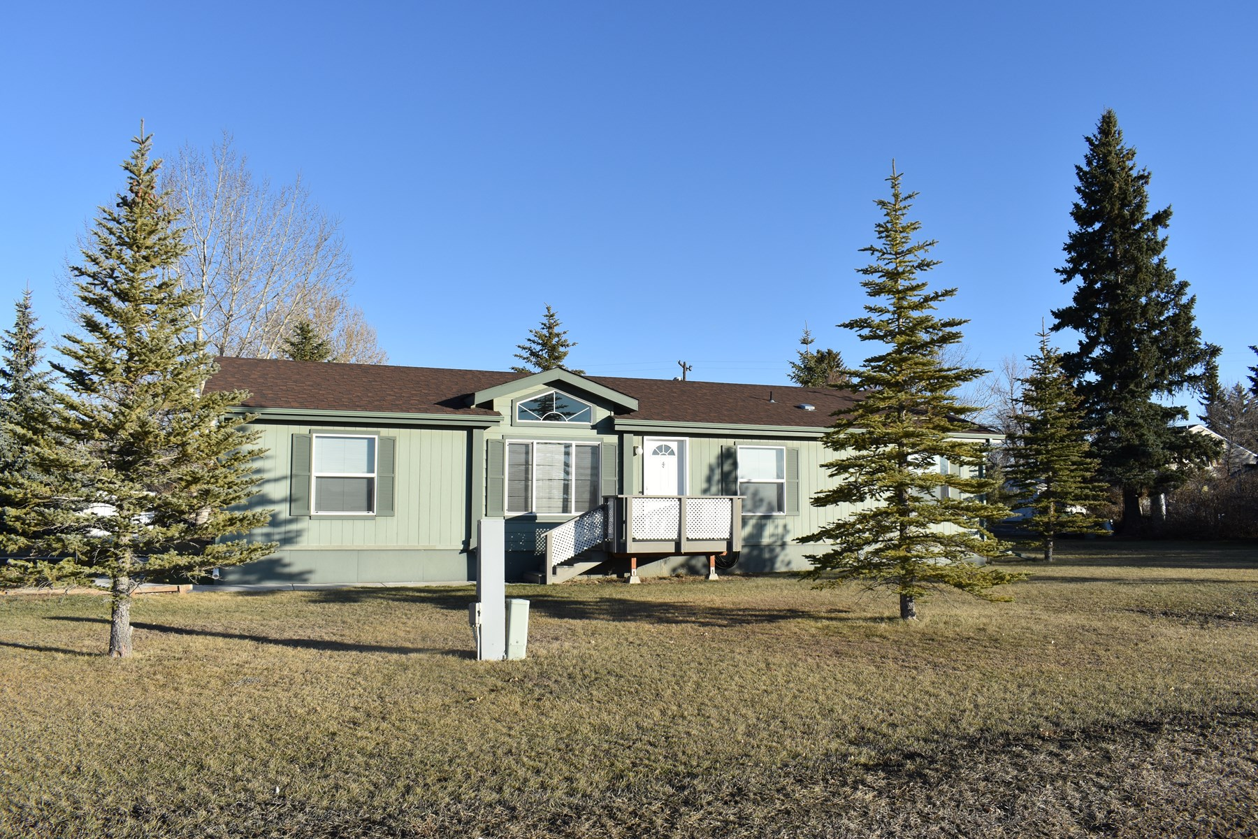Home in town on 1/2 acre of land in Conrad, Montana