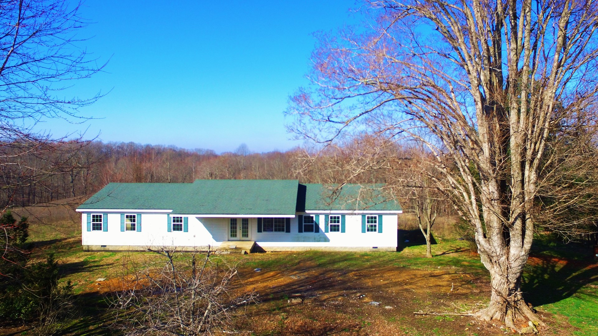 Country home with 12.98 acres