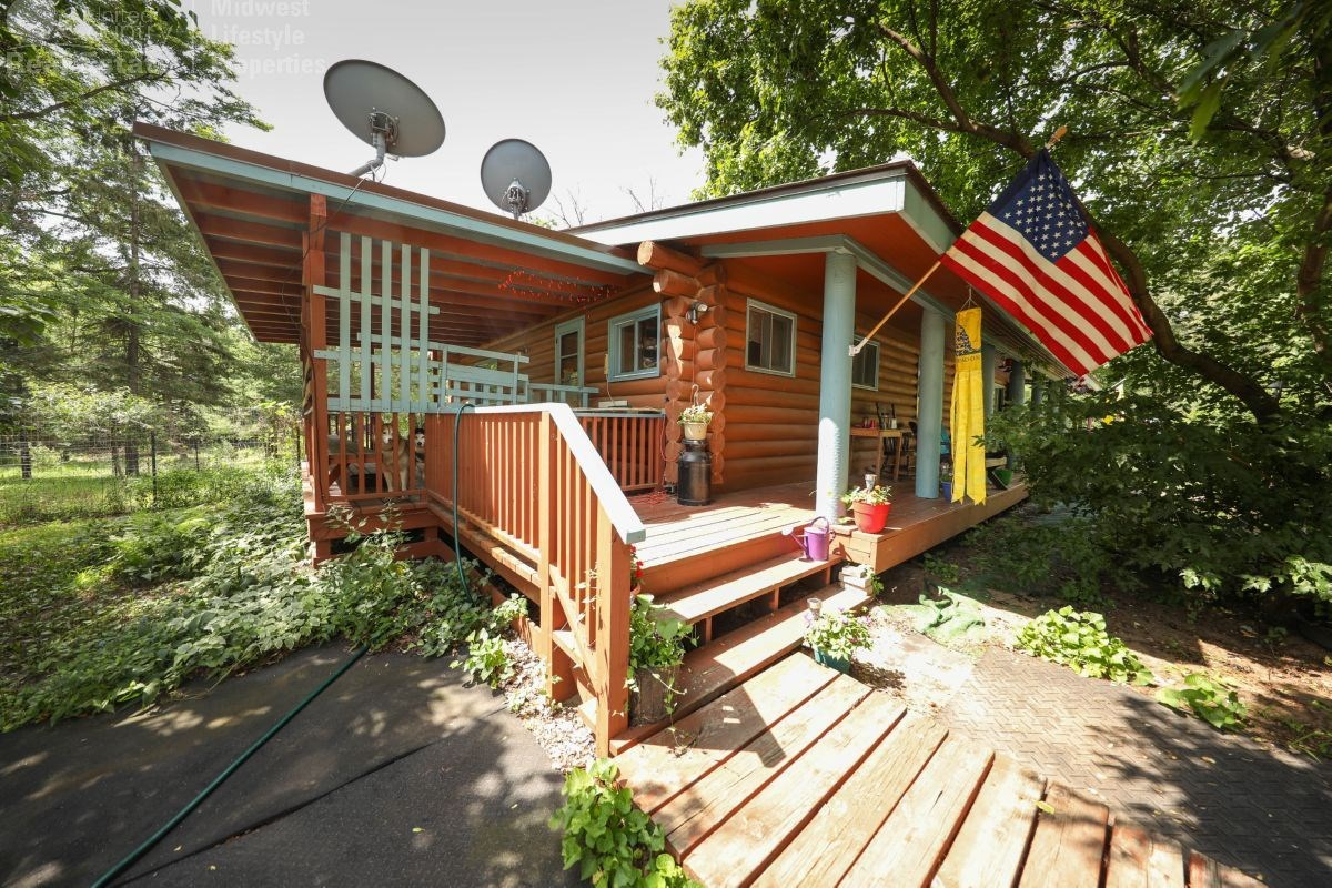Log Cabin in the Woods For Sale in Adams, Wisconsin