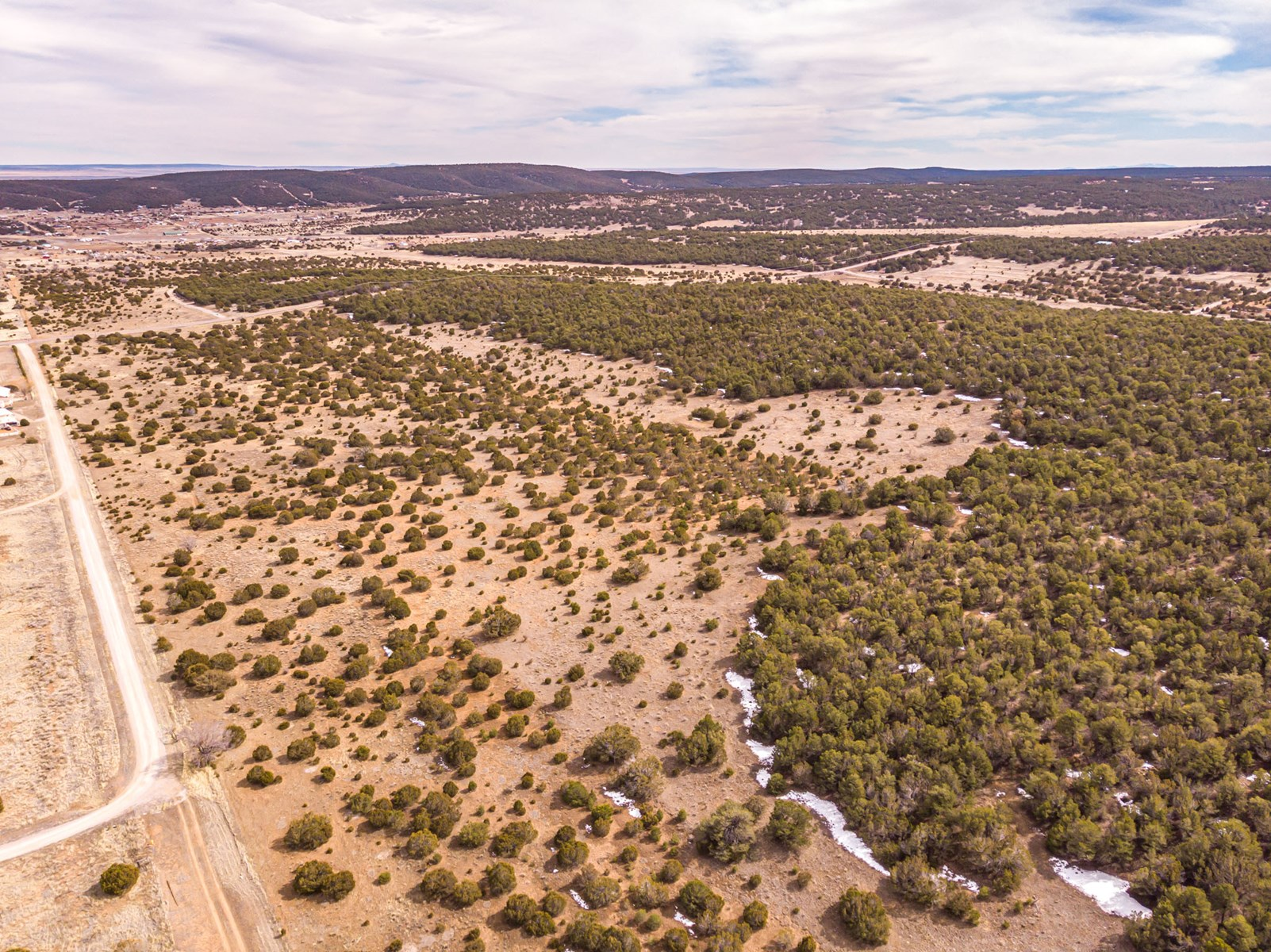 Edgewood, New Mexico 192.17 Acres Wooded with Metal Shop