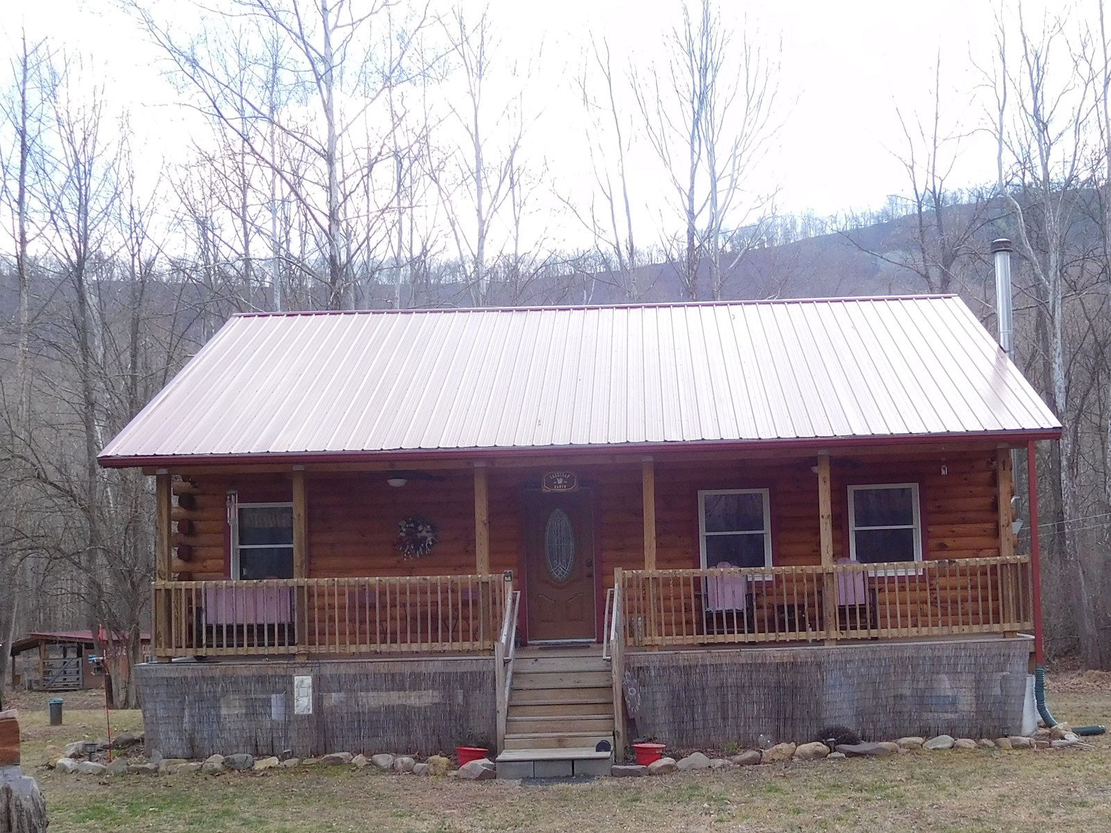 Almost new log home on 3 separate riverfront parcels