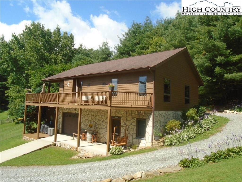 Mountain Home on 4+ acres with a Beautiful Pond!