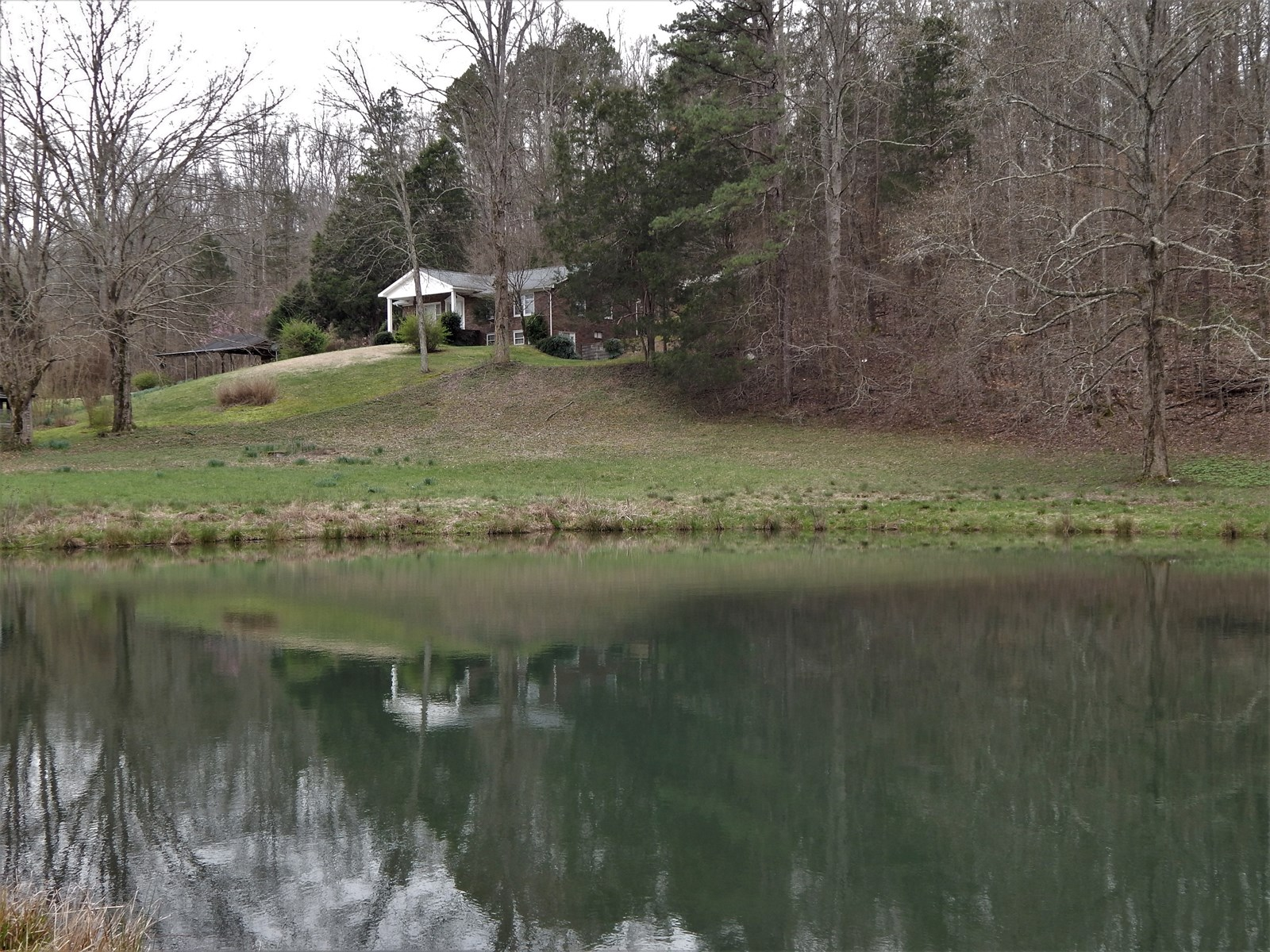 Ranch Style Brick Home For Sale on 39.4 Acres!