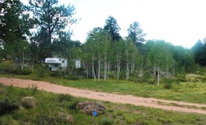 HALF ACRE LOT IN RED FEATHER VILLAGE!