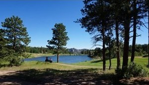 LOT AVAILABLE IN BEAUTIFUL MOUNTAIN GOLF COMMUNITY