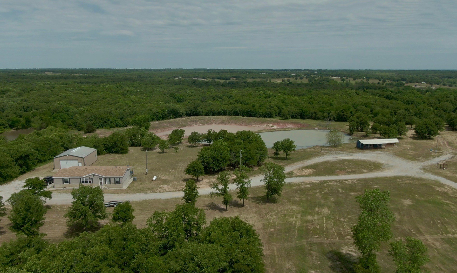 OKLAHOMA COUNTRY HOME ON WOODED ACREAGE W/ HUNTING & FISHING