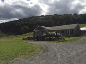 BEAUTIFUL NEWER HOME WITH 133 ACRES IN DERUYTER