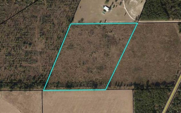 20 acres of natually wooded land off a paved highway.