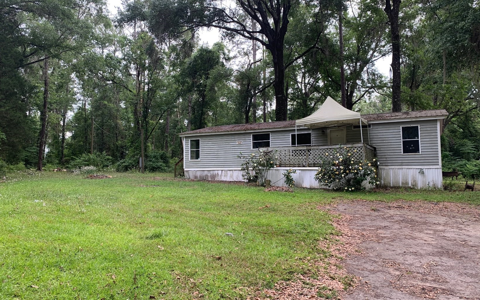 5.15 acres with a 3/2, 1993 doublewide mobile home.