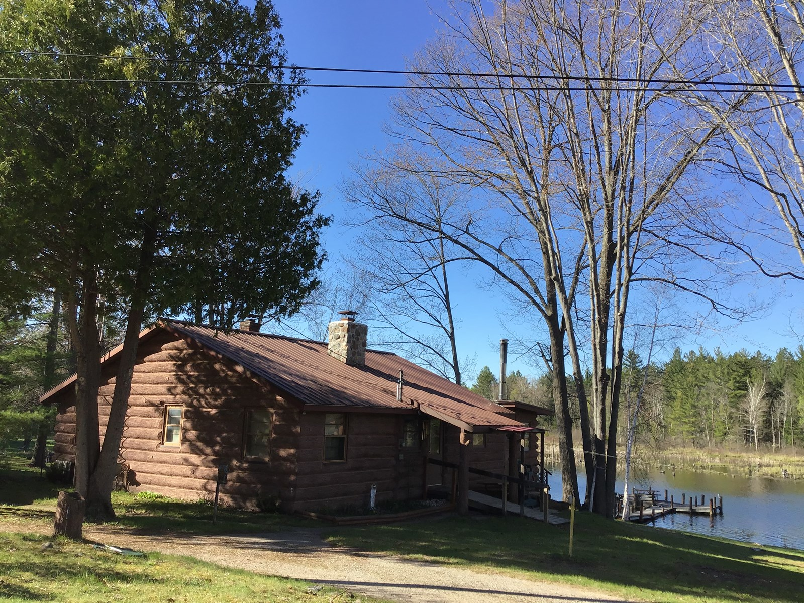 RIVERFRONT LOG CABIN FOR SALE WITH ACREAGE IN ATLANTA, MI