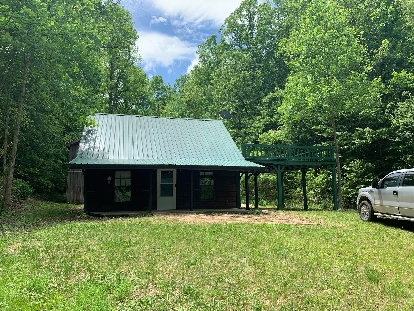 SECLUDED CABIN FOR SALE IN TENNESSEE WITH SHOP AND ACREAGE
