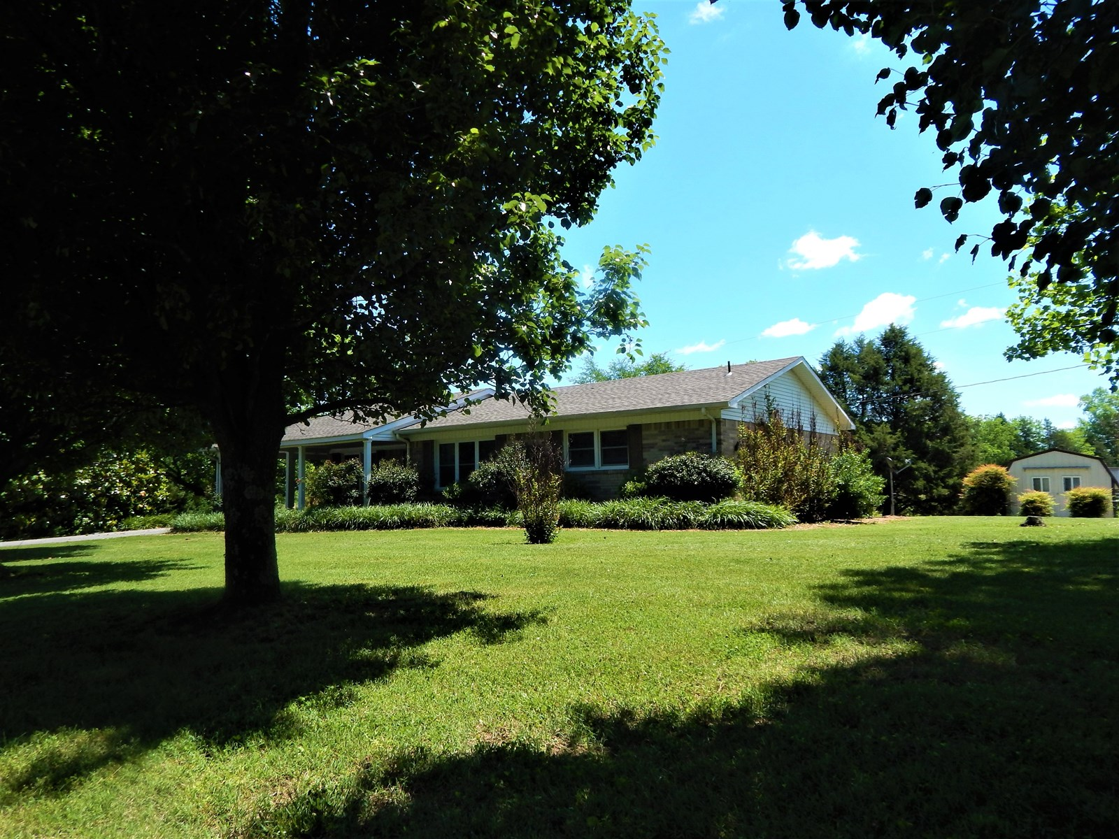 Brick Ranch Style Home With Acreage and Pond!