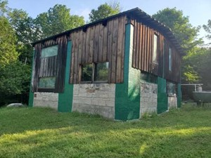 WANT TO GET AWAY FROM IT ALL? SECLUDED CAMP ON 45 ACRES