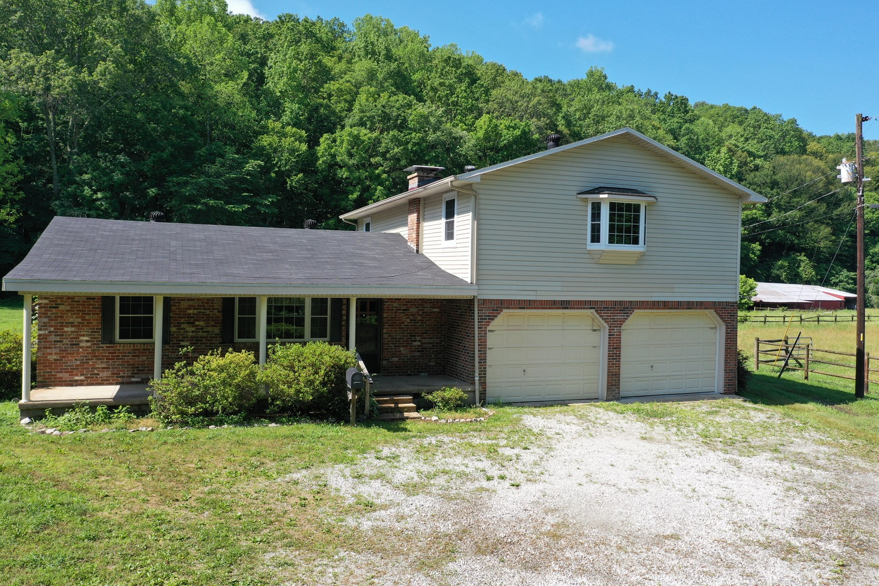 Beautiful Country Property and 4-bedroom Home with Creek!