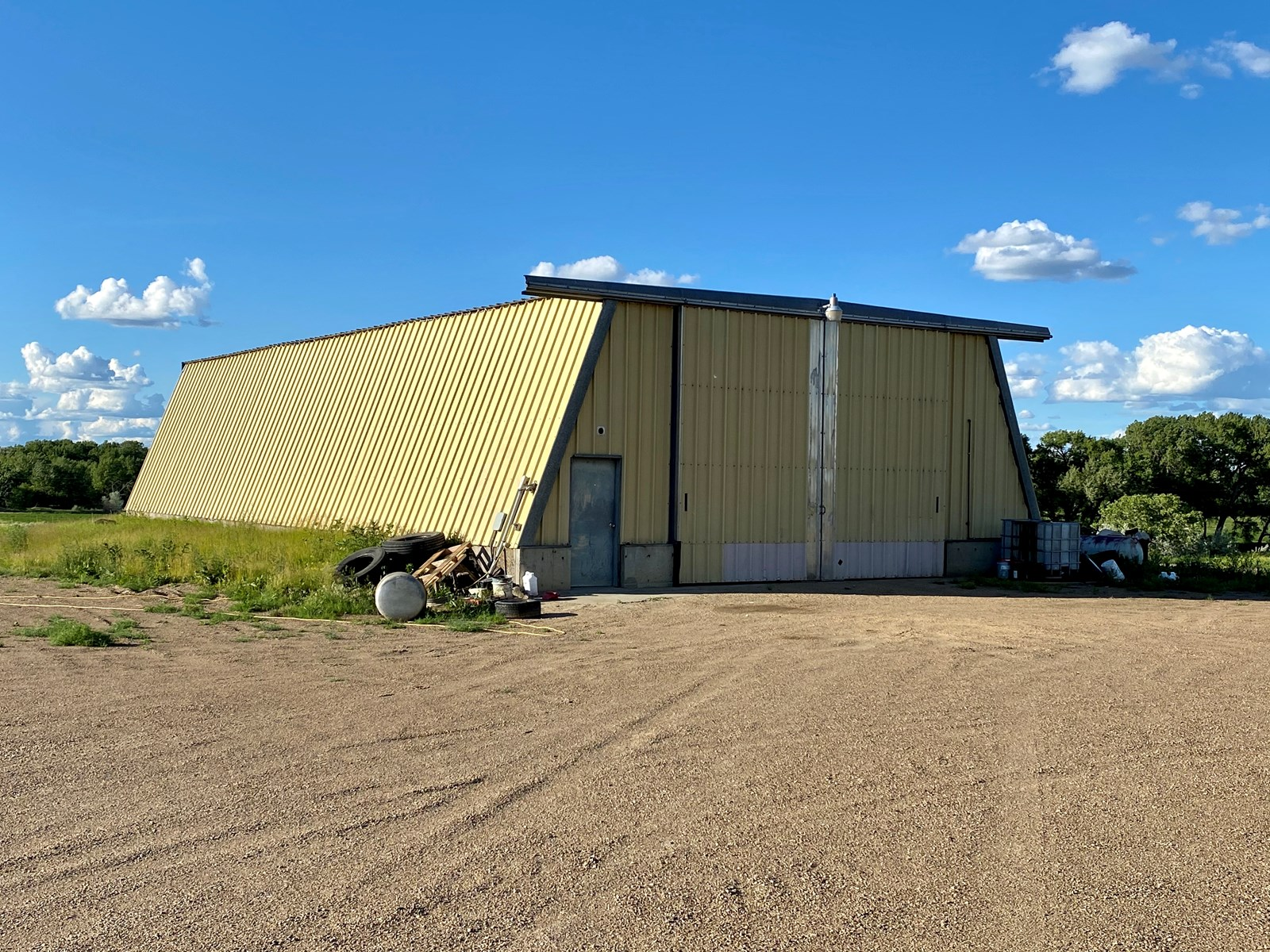 Heated Steel Shop with Concrete Floor on 7+/- Acres