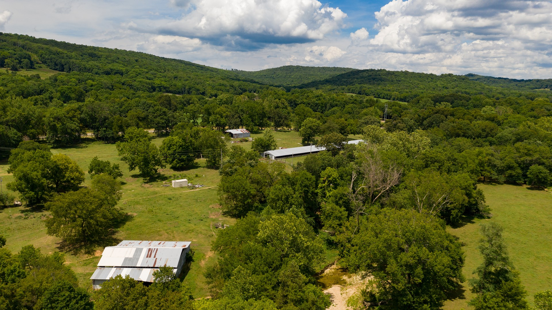 HOME AND  297 ACRES WEST OF STILWELL FOR SALE