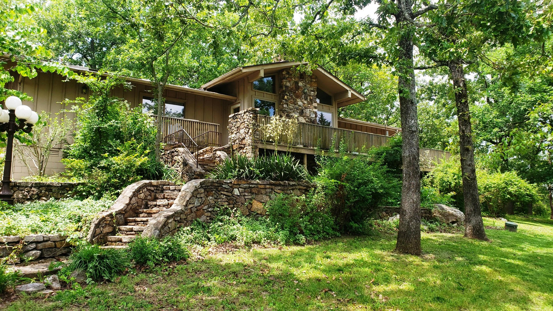 Vista views on this hilltop home in Cheorkee Village AR