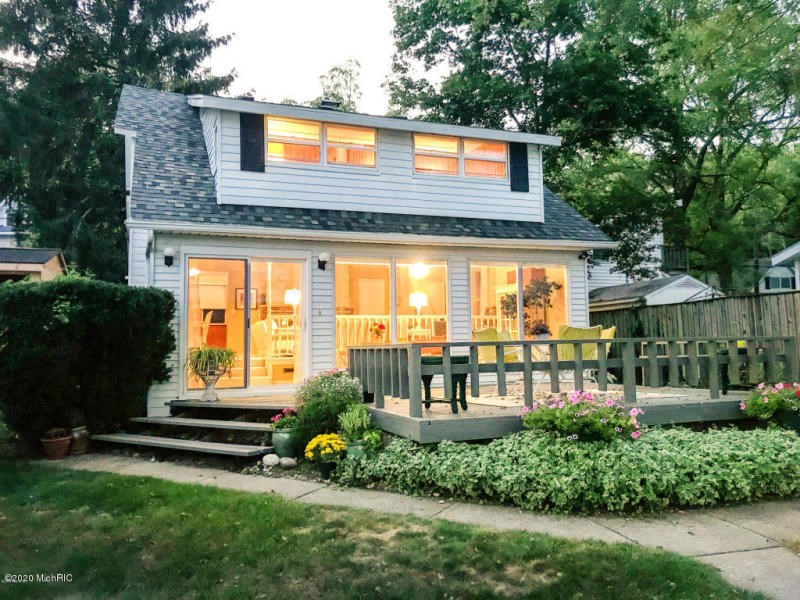 Enjoy Gull Lake year round in this adorable Cape Cod home