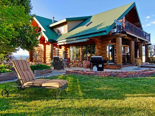 Ranch on 73 acres with custom log home, hay production