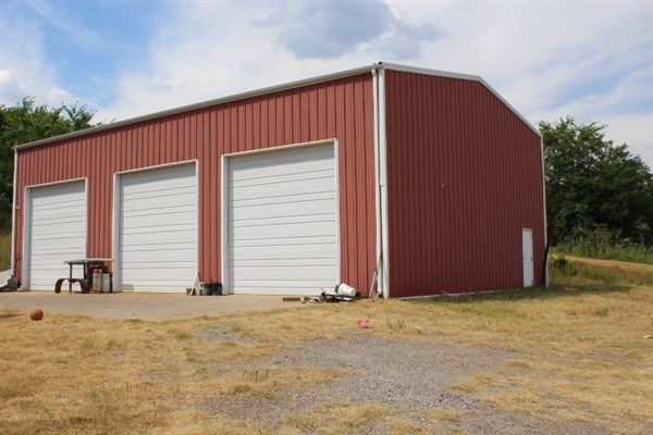 HIGHWAY BUILDING WITH 2 ACRES FOR SALE POTEAU OKLAHOMA