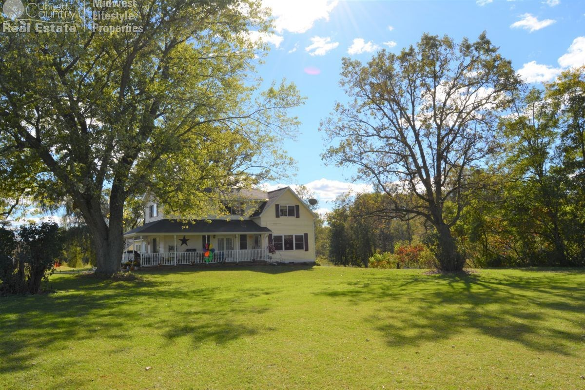 Beautiful Country Home on 4.94 acres between LaValle and Won