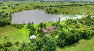 SECLUDED COUNTRY HOME ON 78 ACRES WITH PRIVATE 11 ACRE LAKE