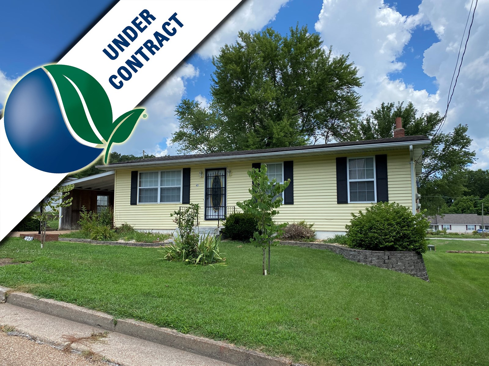 Ranch home with fenced-in double lot for sale in Hermann!