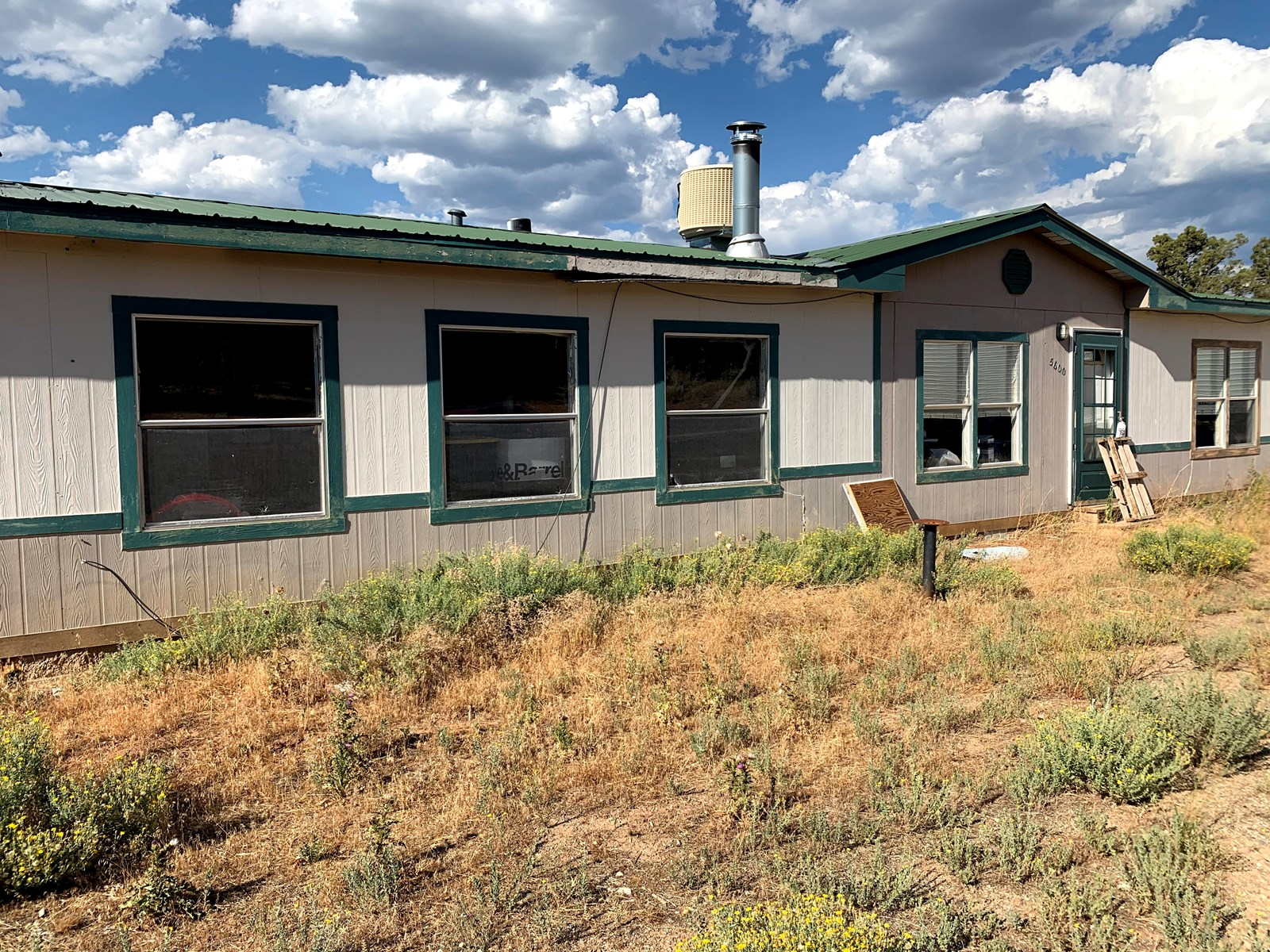 3 BR/2BA home with 2 cabins on 58 acres in Southwest CO