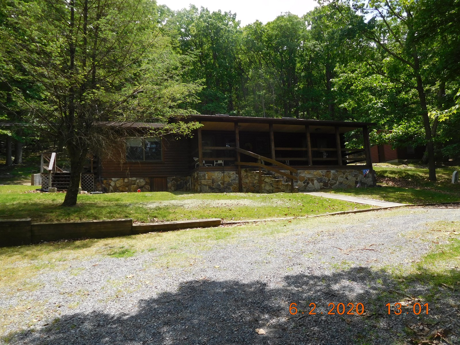 What a great log home on almost 10 wooded acres on two lots