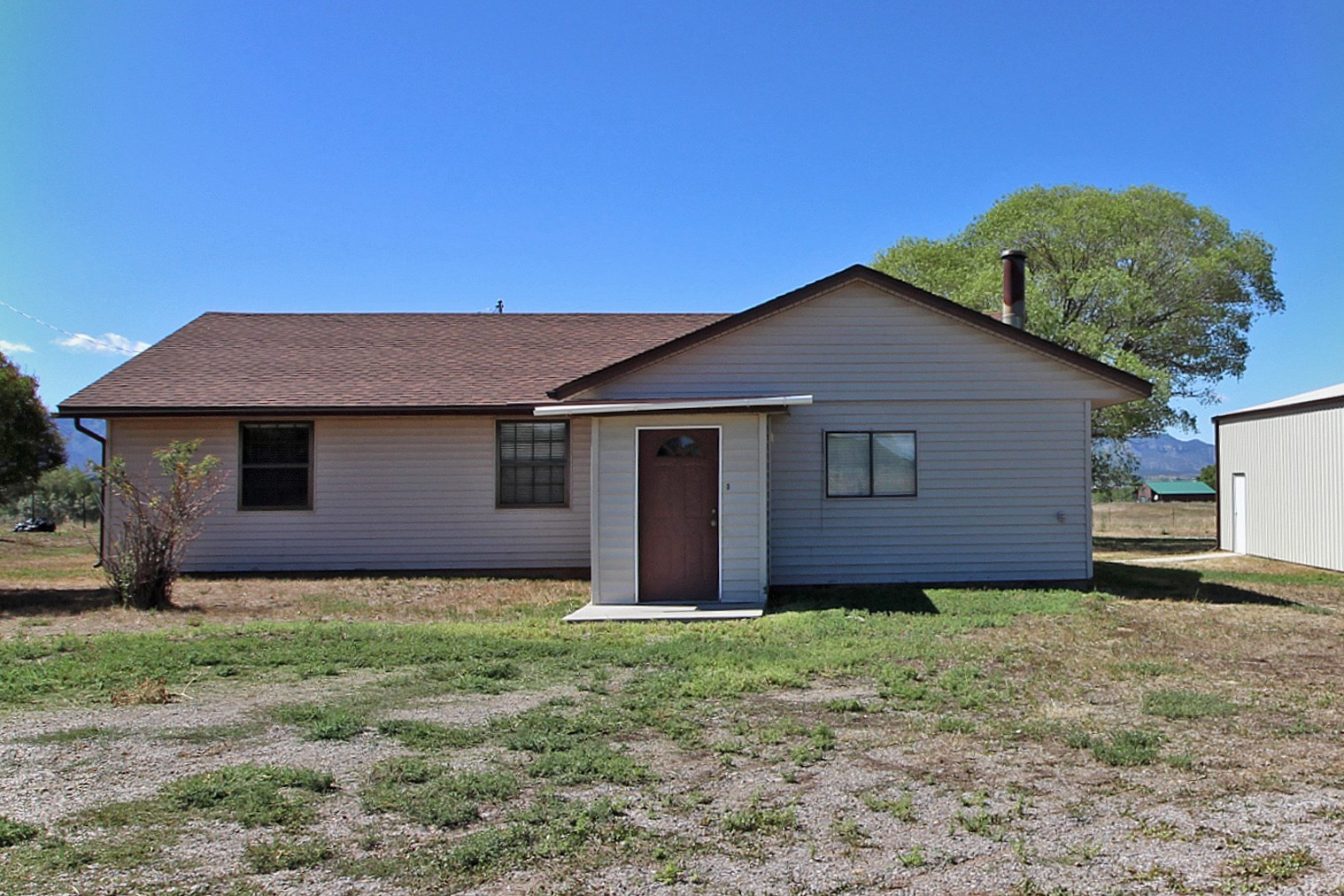 3 BR/2 BA home on 32 acres with irrigation in Dolores,  CO